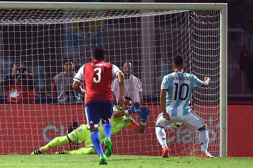 Argentina striker Sergio Aguero sees his penalty kick saved by Paraguay goalkeeper Justo Villar during their World Cup qualifier. Aguero was hoping to equalise from the spot after the visitors took the lead through Derlis Gonzalez.