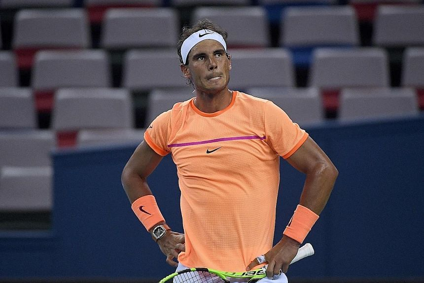 A flustered Rafael Nadal after losing a point against Viktor Troicki. The Spaniard, who has dropped to world No. 5, lost 3-6, 6-7 (3-7) but vowed to get his game in shape during the close season.