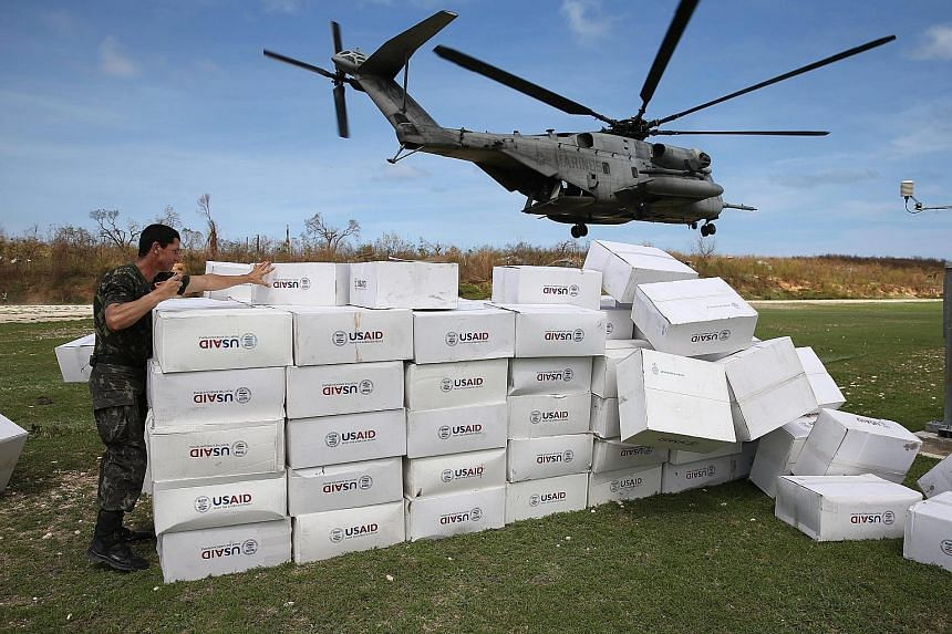 A US military helicopter taking off after unloading humanitarian aid for the Haitian city of Jeremie, which was left devastated by Hurricane Matthew.