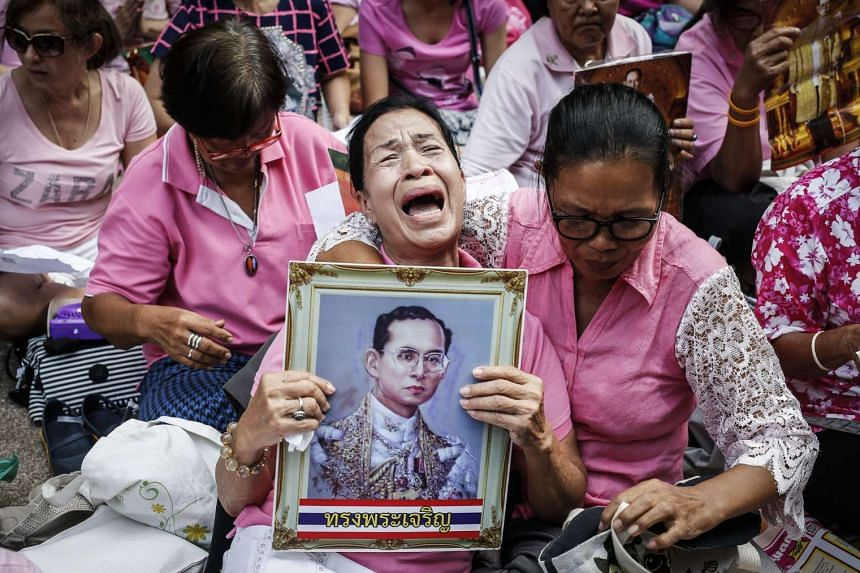 A Thai well-wisher weeps during a prayer for Thai King Bhumibol Adulyadej's recovery at the Siriraj Hospital in Bangkok on Oct 13, 2016.