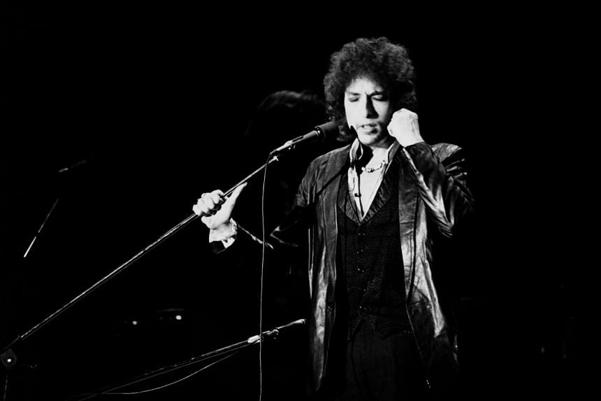 US poet and folk singer Bob Dylan performing in Paris on July 4, 1978.