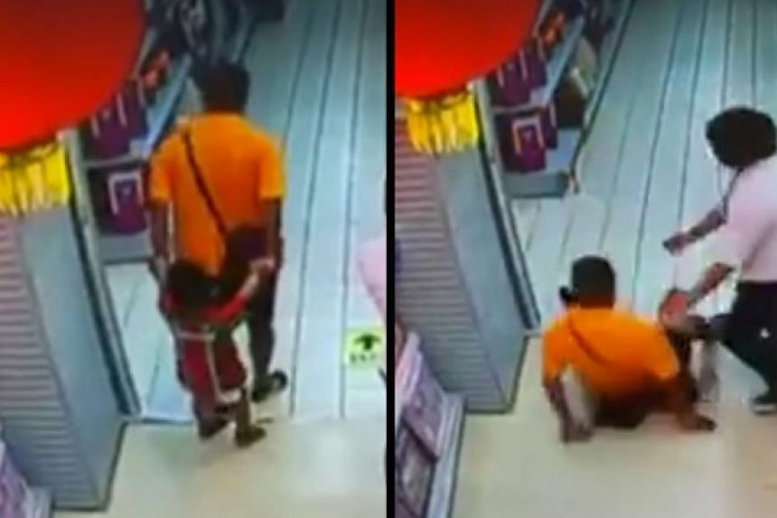 A Chinese boy died in a supermarket after his father accidentally fell on him.
