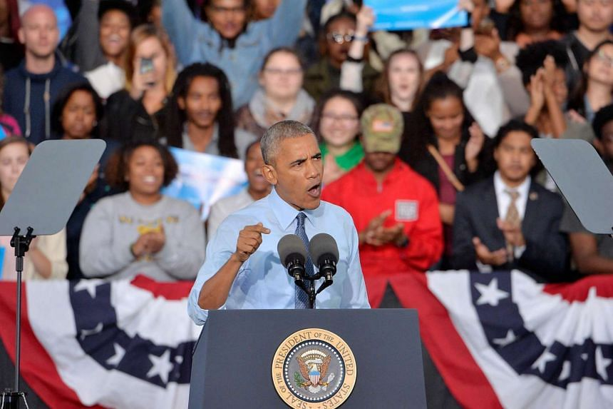 US President Barack Obama campaigns on behalf of Democratic presidential nominee Hillary Clinton on Oct 11, 2016 in Greensboro, North Carolina.