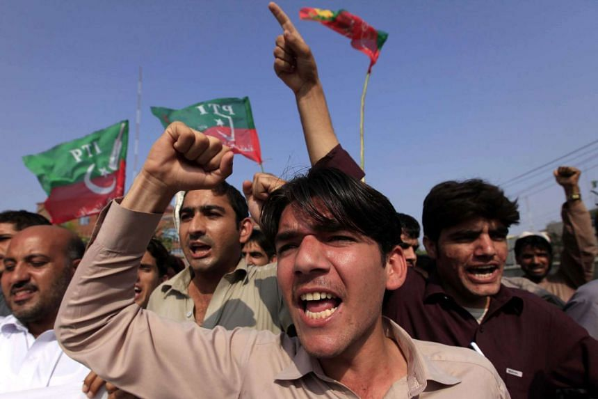 Supporters of Imran Khan, head of opposition party Pakistan Tehrik-e-Insaf (PTI), shout slogans during a protest against India, in Peshawar, Pakistan on Oct 5, 2016.