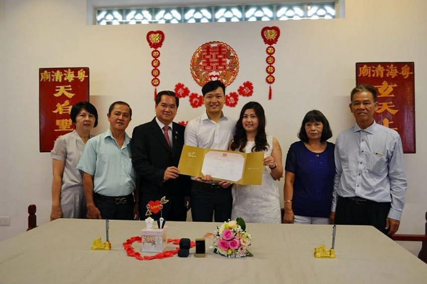 Mr Mah Chun How (centre) and Ms Kang Say See getting married at Yueh Hai Ching Temple in Raffles Place in on Sept 15.