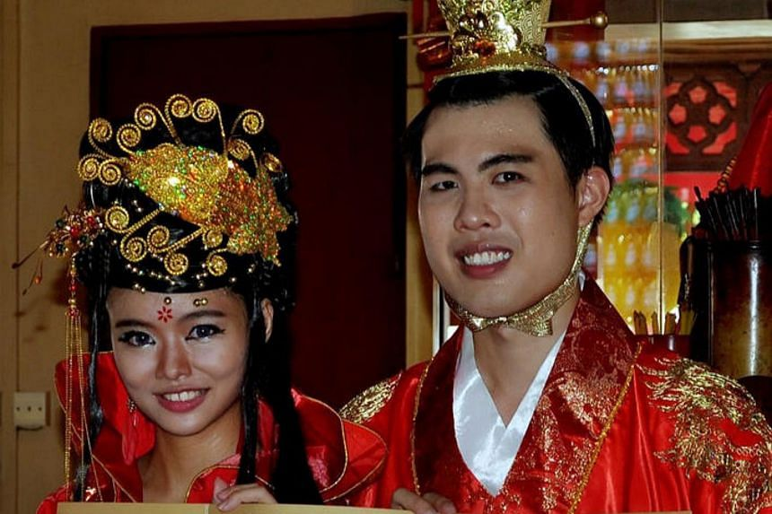 Mr Alan Lim (right) and Ms Teo Yen Ting getting married at Kong Hock Keng Temple in Telok Blangah on June 7, 2015.