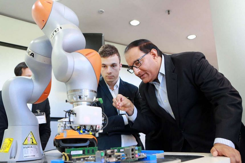 Mr Iswaran takes a closer look at robotics technology displayed by one of Meiban's partners at the Meiban Innovation Centre. Meiban Group has begun to digitalise its factory operations through what it calls the iSmart Factory project.