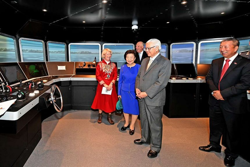 From left: University of Tromso rector Anne Husebekk, Mrs Mary Tan, King Harald V of Norway, President Tony Tan Keng Yam and Non-Resident Ambassador to Norway Ng Ser Miang in the ship navigation simulator at the University of Tromso, Norway, yesterda
