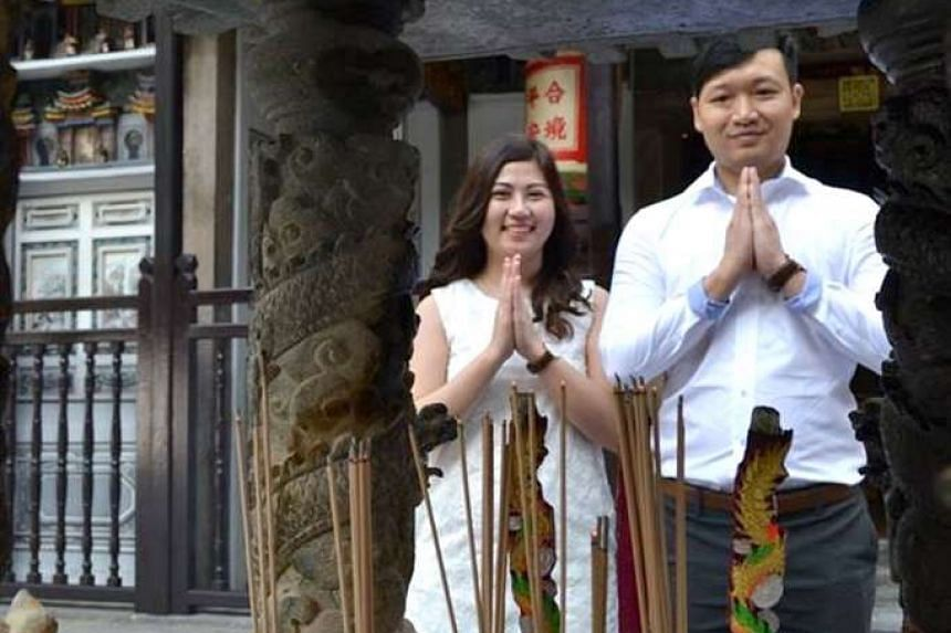Above: Ms Kang and Mr Mah getting married at Yueh Hai Ching Temple in Raffles Place last month.