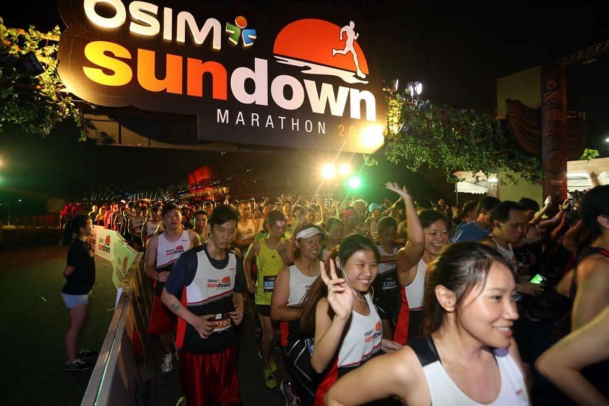 Participants of the 10km race at the Osim Sundown Marathon moving off from their starting point at the F1 Pit Building at 10pm on July 4, 2015.