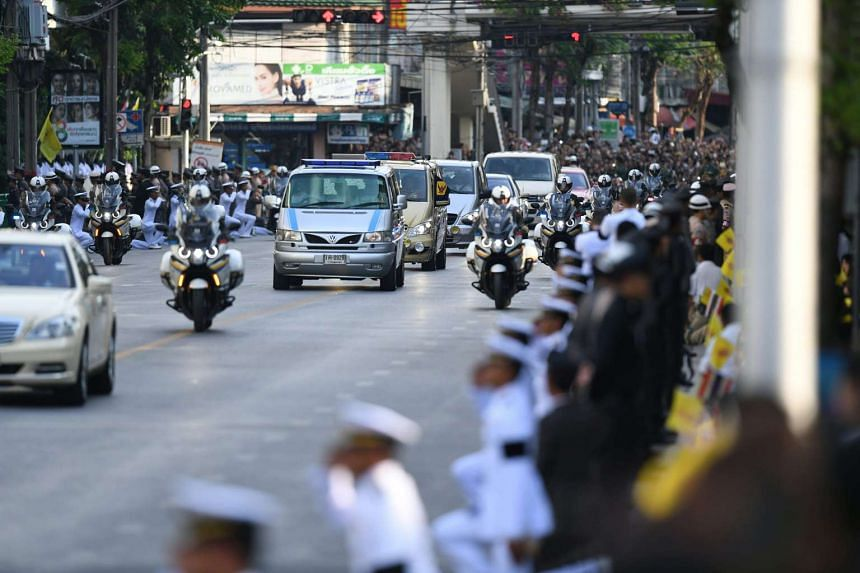 The procession of vehicles moves through the city as massive crowds line the streets during Thai King Bhumibol Adulyadej's body borne to his palace in Bangkok on Oct 14, 2016.