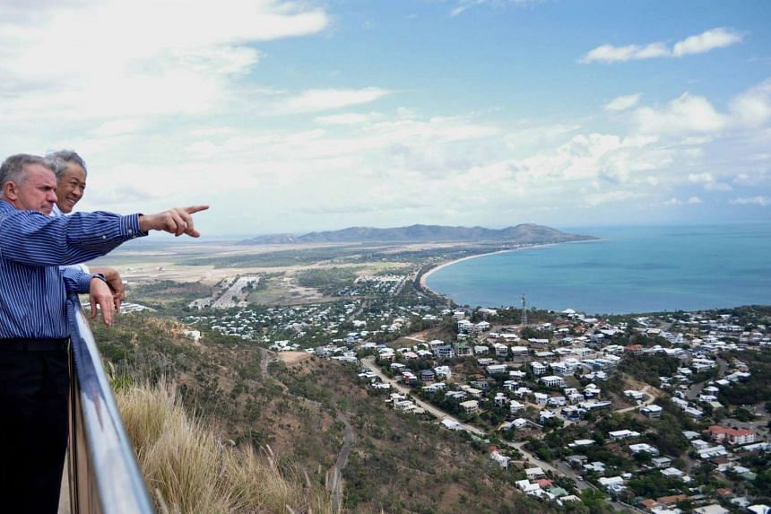 Defence Minister Ng Eng Hen is shown the notable landmarks in the Townsville area by Lieutenant-General (Ret) John Caligari.