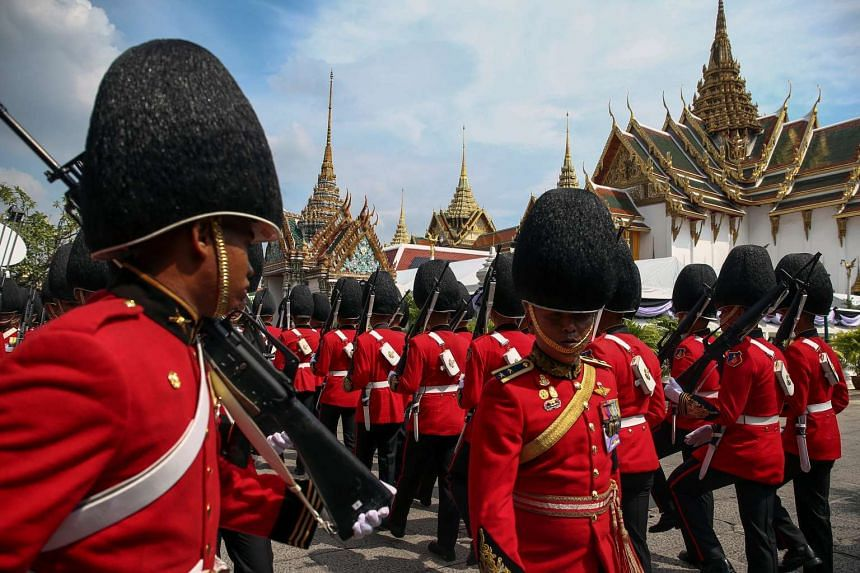 Thai Royal guards march as mourners line up to enter the Grand Palace to pay respect to Thailand's late King Bhumibol Adulyadej in Bangkok on Oct 14, 2016.
