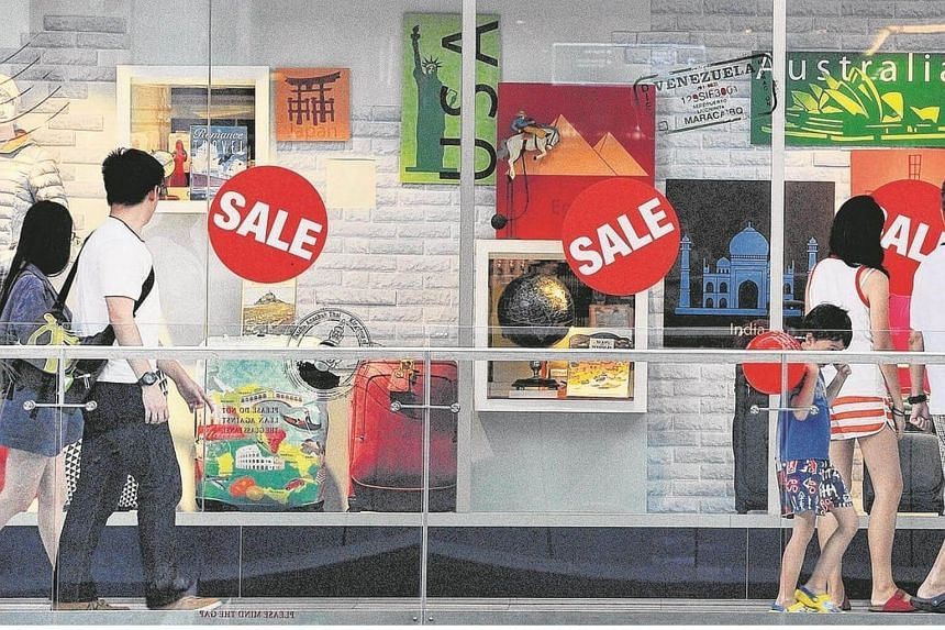 Shoppers walking past baby specialty store Mothercare's storefront at Marina Square. Retail sales reversed course in August, dipping 1 per cent from 2015.