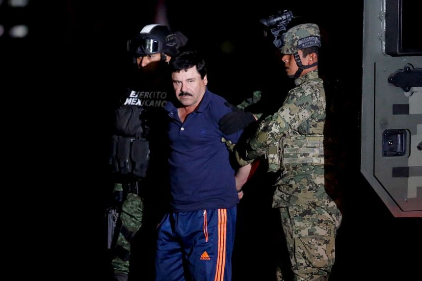 "Joaquin ""El Chapo"" Guzman escorted by soldiers during a presentation in Mexico City, Jan 8, 2016."