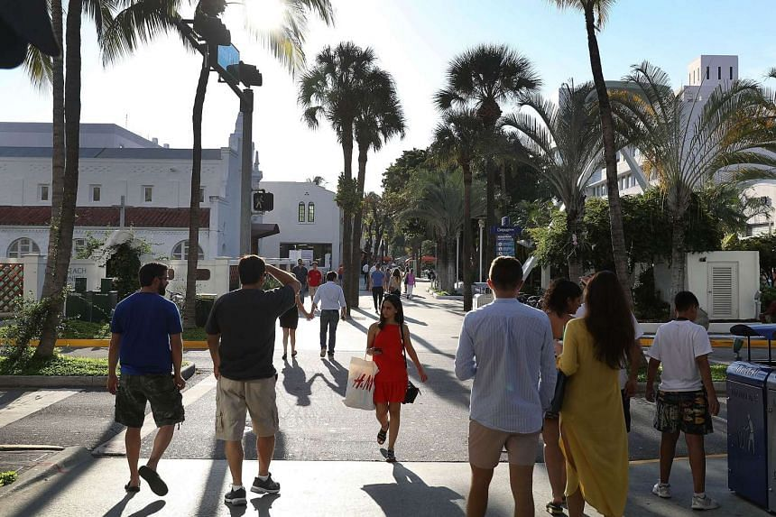 People enjoy themselves along Lincoln Road, an open air shopping space, on the day officials released the locations of the sites where Zika virus was found in trapped mosquitoes on Sept 28, 2016 in Miami Beach, Florida.