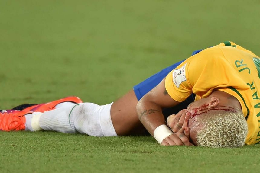 Brazil's Neymar gestures on the ground after being injured in the face during the Russia 2018 World Cup football qualifier match against Bolivia in Natal, Brazil, on Oct 6, 2016.
