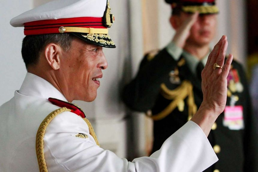 Thailand's Crown Prince Maha Vajiralongkorn waves to well-wishers who had gathered to see King Bhumibol Adulyadej before he departed to the Grand Palace from Siriraj Hospital to take part in his coronation anniversary ceremonies in Bangkok, Thailand