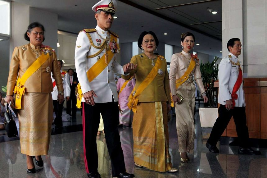 Thailand's Queen Sikirit (centre), Crown Prince Maha Vajiralongkorn (2nd L), Princess Chulabhorn (2nd R) and Princess Maha Chakri Sirindhorn (L) follow King Bhumibol Adulyadej (not pictured) as he returns to the Siriraj Hospital after a ceremony at t