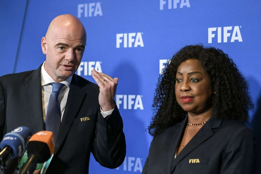 Fifa president Gianni Infantino (left) gestures next to FIFA Secretary General Fatma Samoura during a press briefing on Oct 13, 2016 at the world football's governing body headquarters in Zurich.