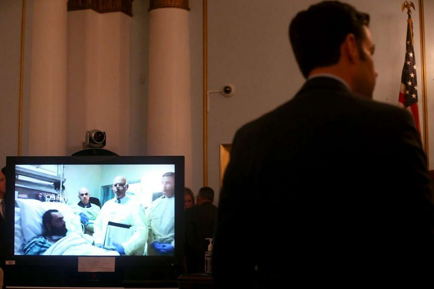 Suspected bomber Ahmad Khan Rahimi appears on a screen via a Skype video connection from University Hospital in Newark, New Jersey, during hearing before Superior Court Judge Regina C. Caulfield at the Union County Courthouse in Elizabeth, New Jersey