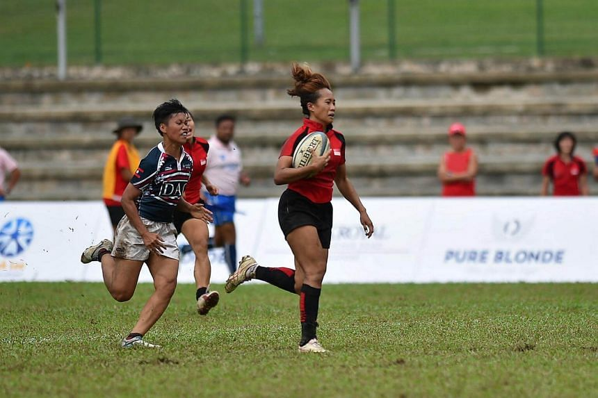 Singapore national women's rugby team in action during the HSBC World Rugby Singapore Sevens held in April 2016.