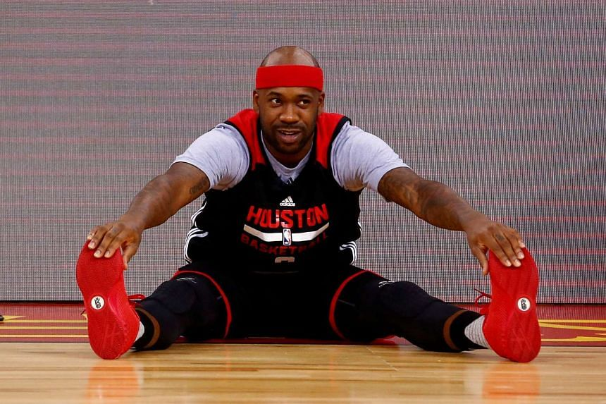 Houston Rockets player Bobby Brown stretches before training on Oct 11, 2016.