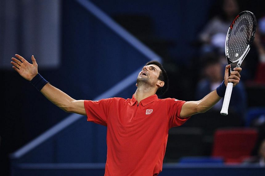 Novak Djokovic reacts after to a point against Mischa Zverev of Germany during their men's singles match at the Shanghai Masters tennis tournament on Oct 14, 2016.