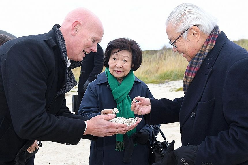 Mr Kjell Ove Hveding, host of Sommaroy Arctic Hotel, showing Dr Tony Tan and Mrs Mary Tan corals that were washed up on the shores. Dr Tan was briefed on Sommaroy's coastal environment and economic activity.