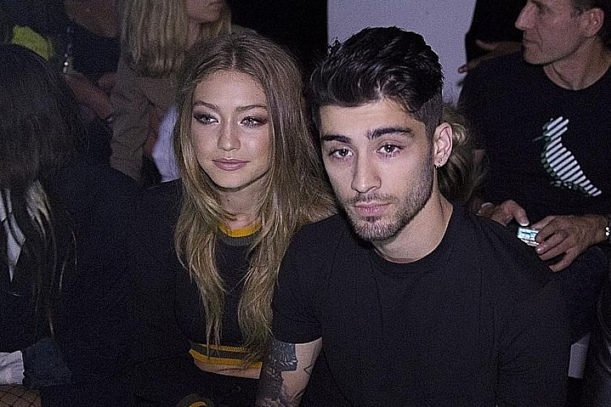Model Gigi Hadid with singer Zayn Malik at the Versus Versace show during London Fashion Week last month.