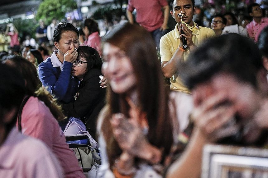Thais reacting to the announcement of King Bhumibol's death outside the Siriraj Hospital yesterday. A Royal Palace statement issued in Bangkok yesterday said that the King, 88, died in the hospital. During his reign, the well-loved monarch had create