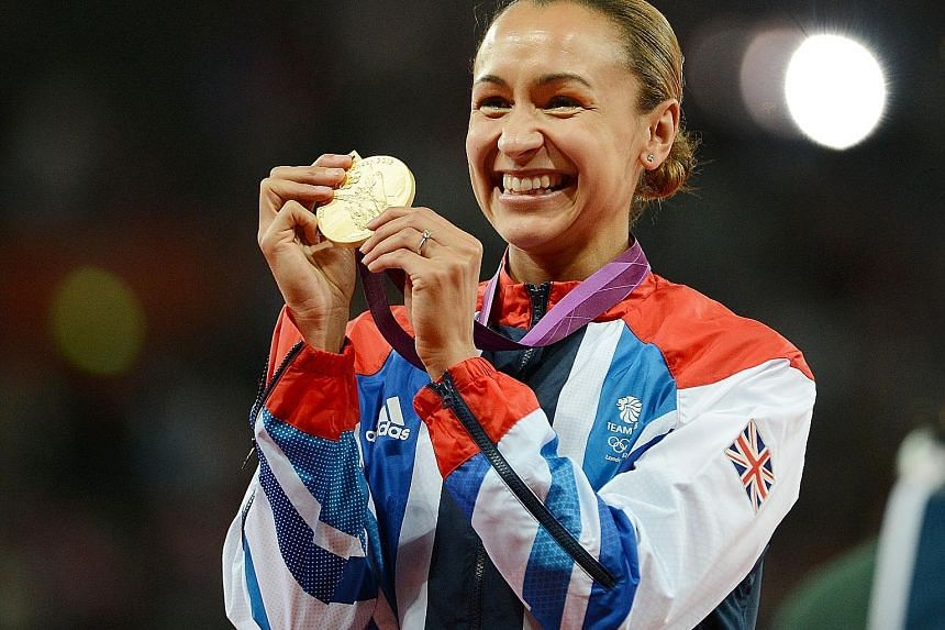 Briton Jessica Ennis-Hill celebrating her heptathlon gold at the 2012 London Olympics. She took silver at August's Rio Games.