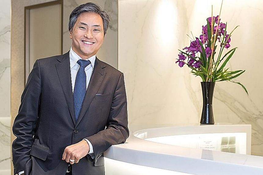 Fullerton Health, co-founded by Dr Michael Tan (above), had planned to open its IPO to individuals this week. The base offer will consist of 140.3 million shares, according to the preliminary prospectus.