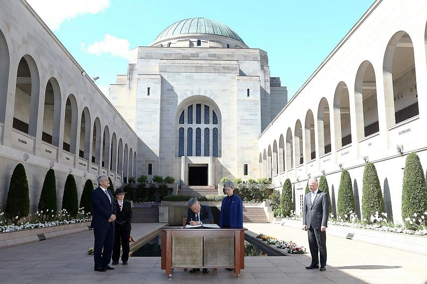 PM Lee and Mrs Lee at the Australian War Memorial in Canberra yesterday after laying a wreath. With them are the memorial's chairman Kerry Stokes (left) and director Brendan Nelson (right).