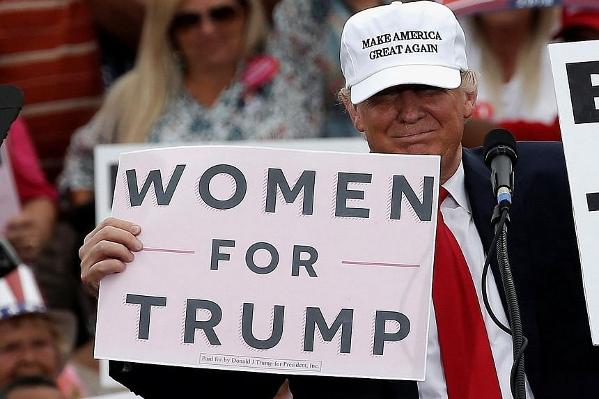 Mr Trump at a campaign rally in Lakeland, Florida, on Wednesday. Mr Trump said during his debate with Mrs Clinton on Sunday that he had not forced himself on women.