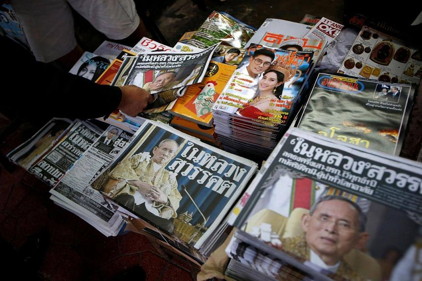Newspapers carry the headlines of the passing of Thailand's King Bhumibol Adulyadej in Bangkok, on Oct 14, 2016.