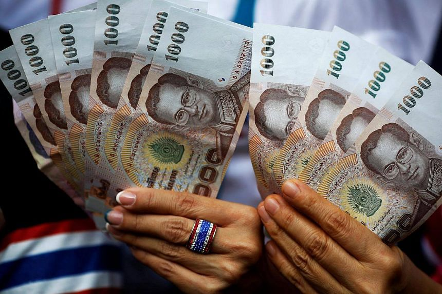 The baht rose on Friday (Oct 14) along with an exchange-traded fund tracking Thailand's shares following the death of King Bhumibol Adulyadej.
