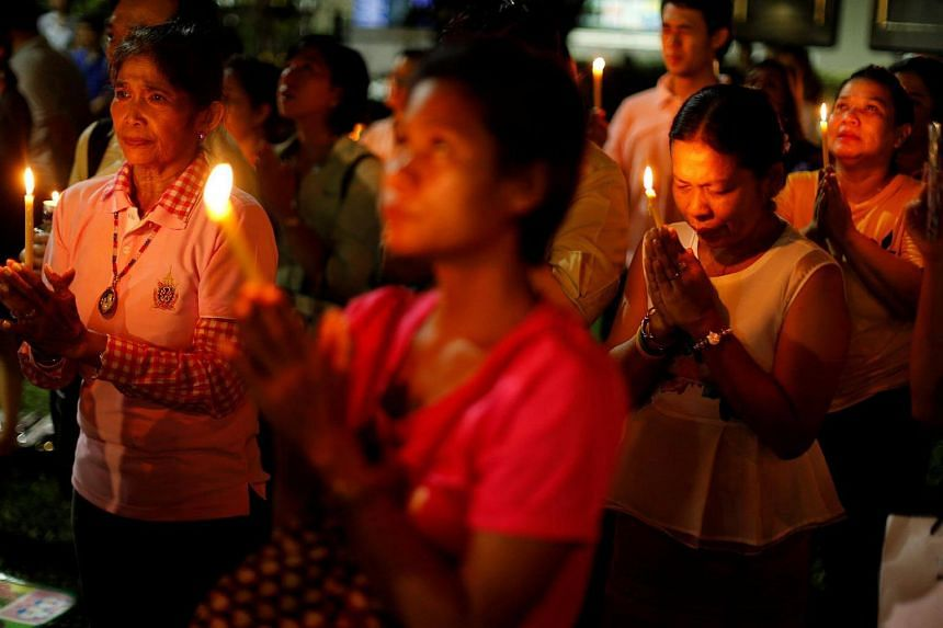 People mourn after an announcement that Thailand's King Bhumibol Adulyadej has died, at the Siriraj hospital in Bangkok.