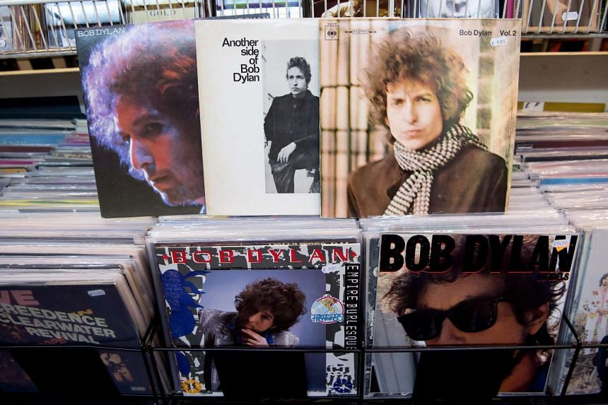 Records by US singer-songwriter Bob Dylan lie in a record store in Munich, Germany, Oct 13, 2016.