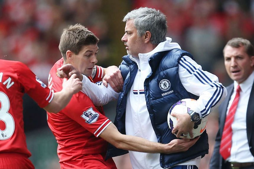 Liverpool's Steven Gerrard (left) attempts to get the ball off Chelsea manager Jose Mourinho.