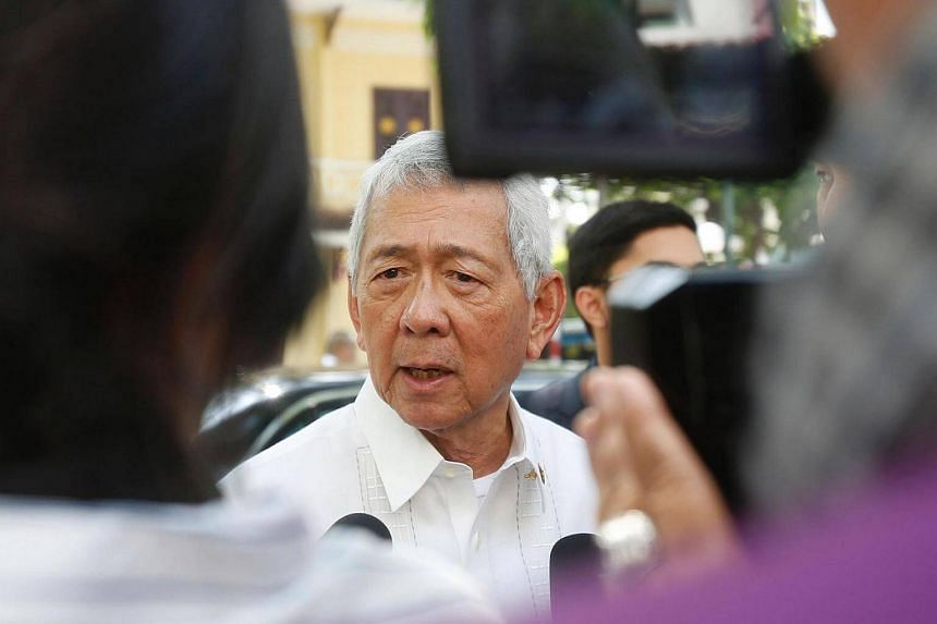 Philippines Foreign Secretary Perfecto Yasay speaks with media outside a restaurant in Hanoi, Vietnam on Sept 29, 2016.