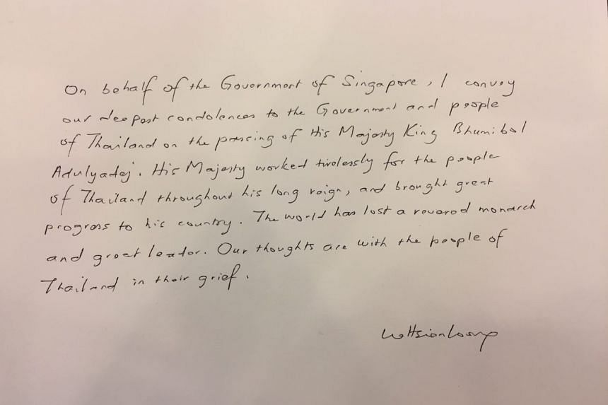 Prime Minister Lee Hsien Loong's message in the condolence book for late King Bhumibol Adulyadej at the Thai Embassy in Singapore on Oct 14, 2016.