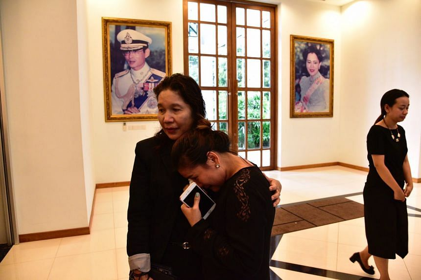 A woman weeps as she pays her respects to late King Bhumibol Adulyadej at the Thai Embassy in Singapore on Oct 14, 2016.
