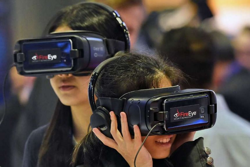 Visitors at Singapore International Cyber Week 2016 checking out virtual reality goggles. Whether Singapore can be a secure Smart Nation depends on the extent to which those with a vested stake - including ordinary citizens - rise to the challenge of cybe