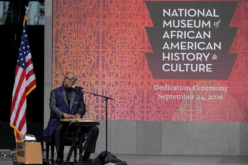 Musician Stevie Wonder performs during the dedication of the Smithsonian's National Museum of African American History and Culture in Washington.