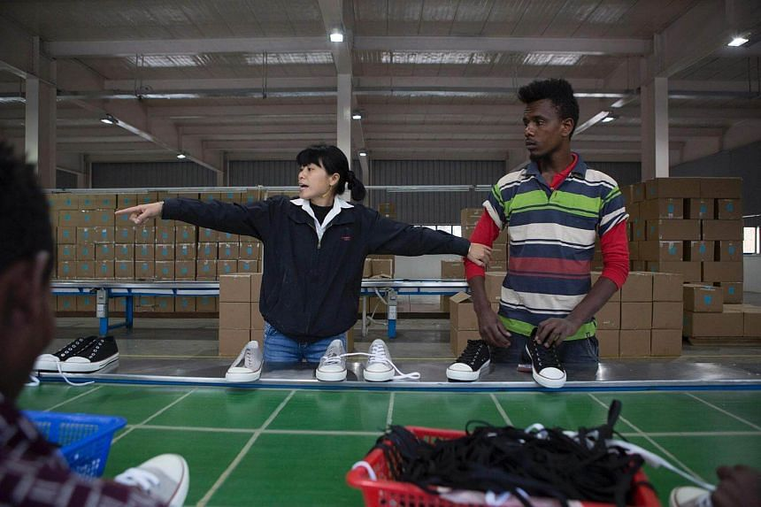 An Ethiopian and Chinese worker inside the Huajian shoe factory on the outskirts of Addis Ababa.