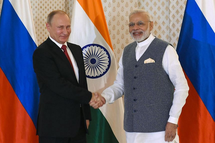 Indian Prime Minister Narendra Modi (right) with Russian President Vladimir Putin ahead of the Indo-Russia Annual Summit in Goa on Oct 15, 2016.