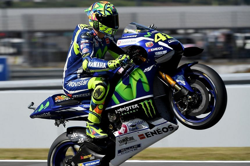 Charmaine Ng XT: Movistar Yamaha MotoGP's rider Valentino Rossi does a wheelie during a practice session at the Japanese Grand Prix on Oct 15, 2016.