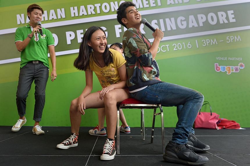 Nathan Hartono playing musical chairs with fans, at Bugis+ on Oct 15, 2016.