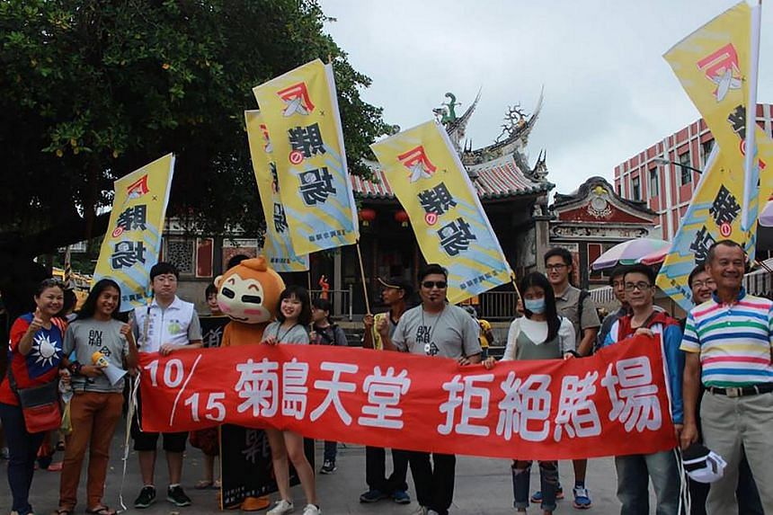 """An anti-casino demonstration in Penghu, Taiwan, on Oct 8, 2016. The banner reads """"Refuse the casino""""."""